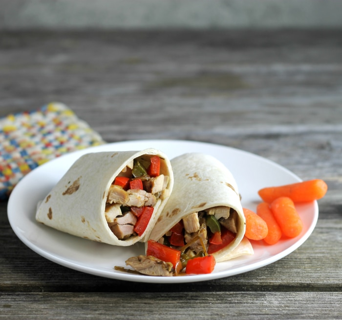 Soft Italian chicken wraps filled with chicken, peppers, and onions