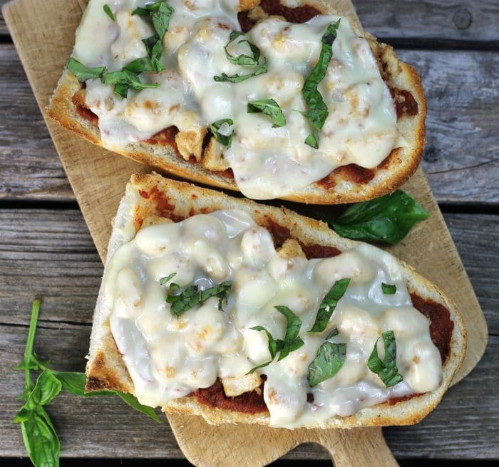 Chicken Parmesan French Bread Pizza a simple delicious pizza ready in under 30 minutes that combines chicken parmesan and pizza all into one.