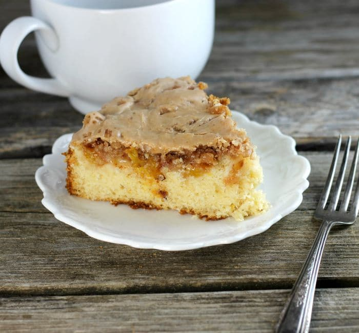 Fresh peach coffee cake is a soft moist cake topped with fresh peaches, crumble toppingand icing. It is great tomake on lazy Sunday mornings.