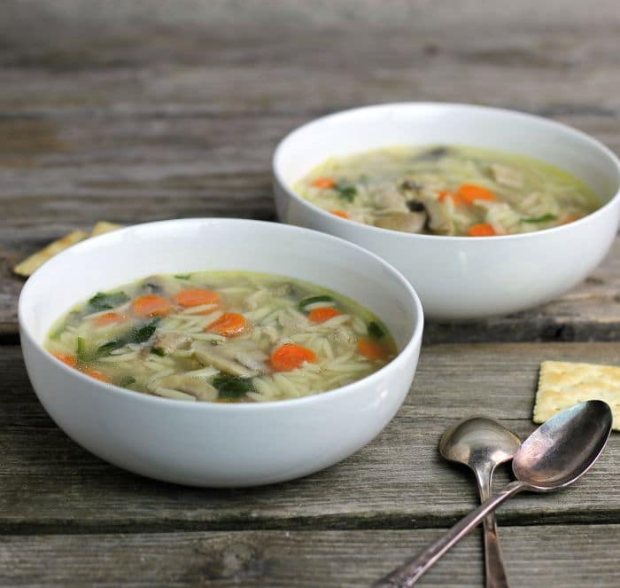 Chicken orzo soup a simple soup with great flavor made with cooked chicken, orzo, carrots, mushrooms, and spinach total comfort food.
