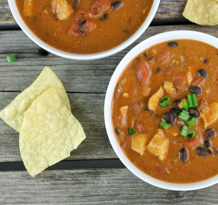 Chicken Enchilada Chili a hearty chili made with enchilada sauce, black beans, chili beans, tomatoes and more, easy to make and totally delicious.