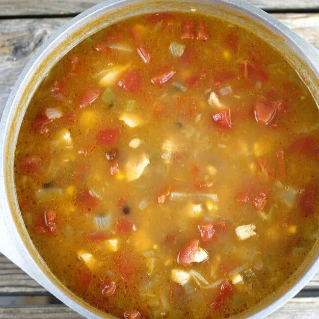 A Dutch oven full of 3 bean soup.