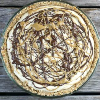 Peanut butter pie with chocolate and peanut butter drizzled over top.