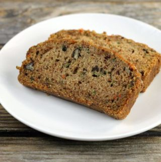 Two slice of zucchini bread on a white plate.