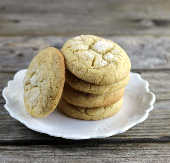 A stack of cookies with a cookie on the side.