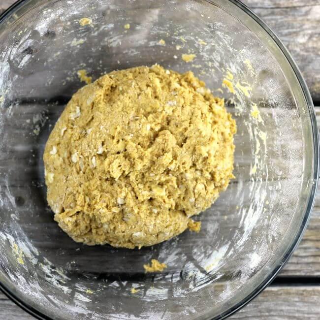 Pumpkin scone dough in a glass bowl.