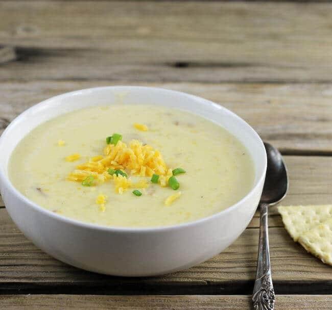 Side angle view of a bowl of potato soup.