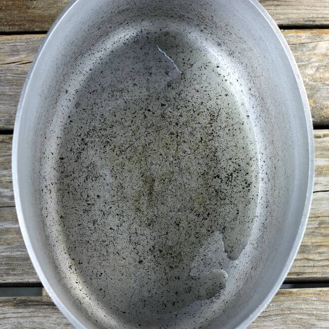 Dutch oven with oil in the bottom.