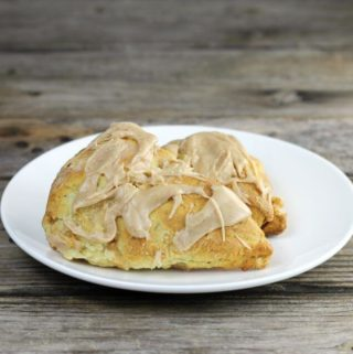 Two apple scones on a white plate.