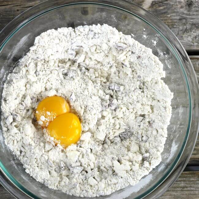 Add egg yolks to the flour mixture.