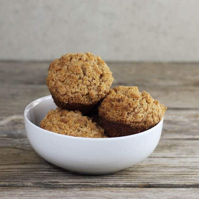 a bowl filled with carrot muffins.