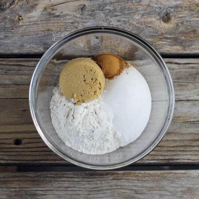 Flour, sugar, and cinnamon in a glass bowl.