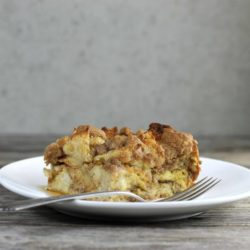 French toast bake on a white plate with a fork.
