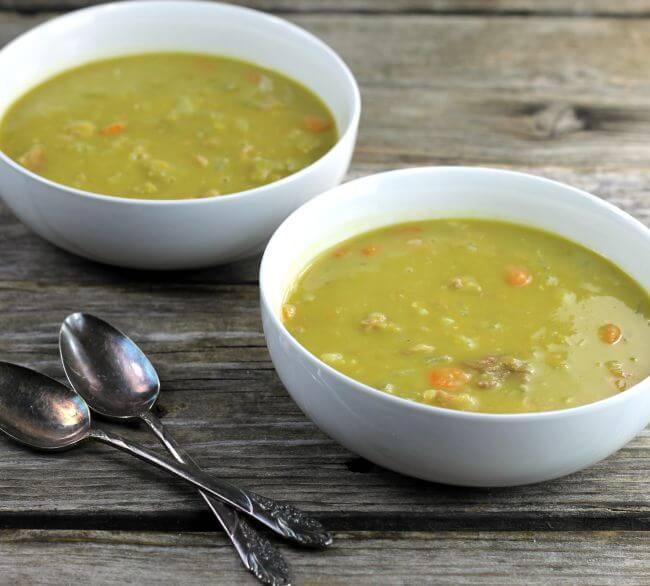 Two bowls of split pea soup, a side view.