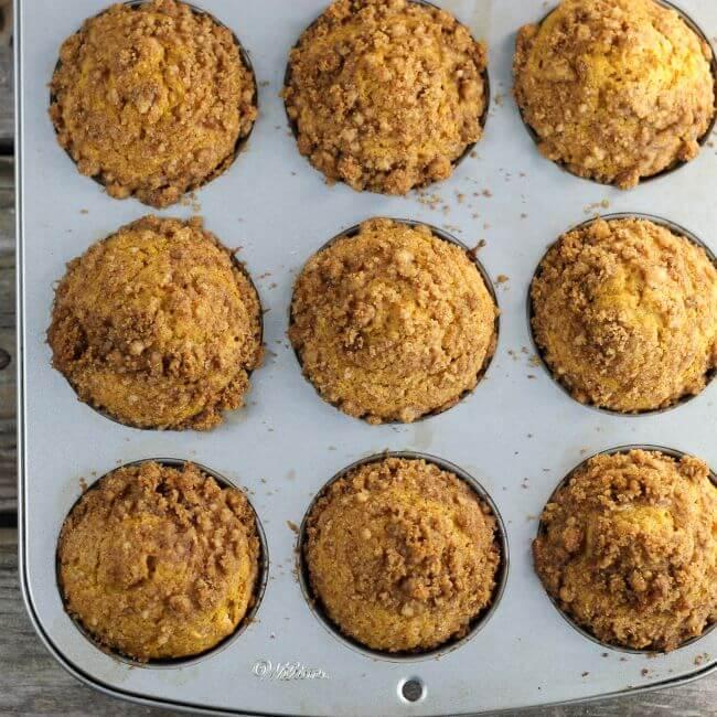 Baked pumpkin muffins in tins.