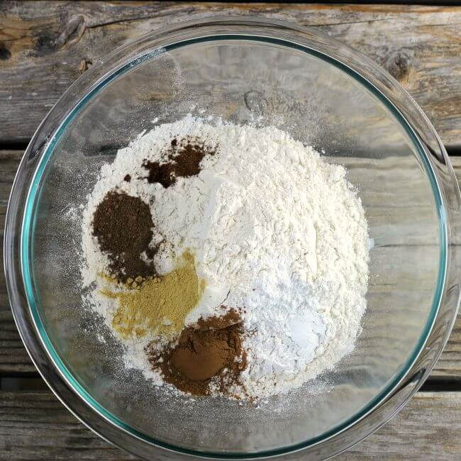 Flour and spices in a glass mixing bowl.