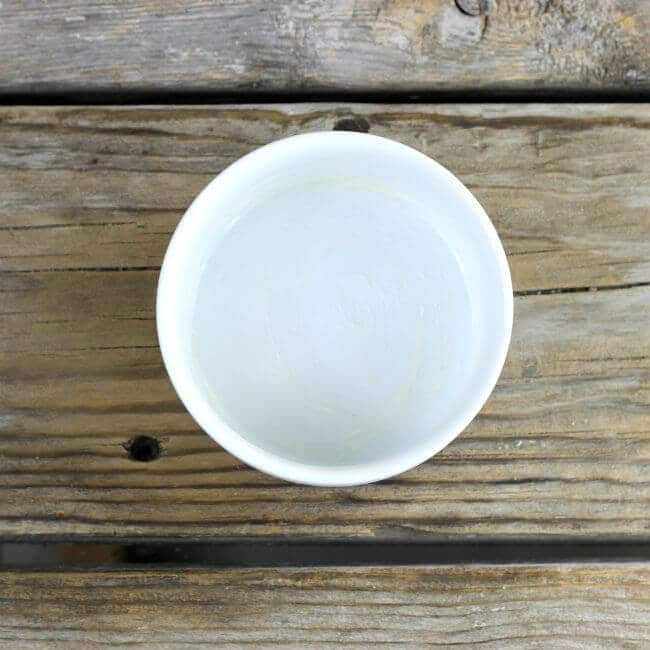 A ramekin that has been greased with butter.