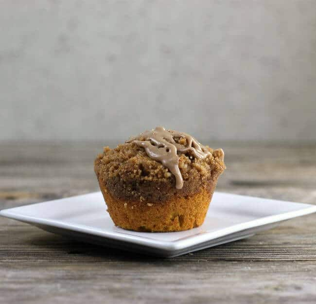 Side view of muffin on a white plate.