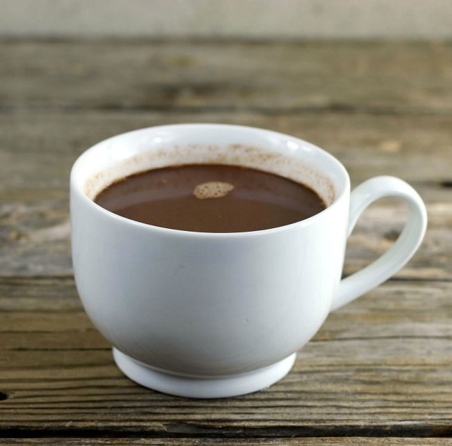 A side view of a cup of hot chocolate.
