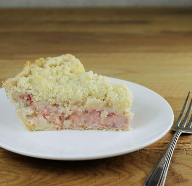 A side view of a rhubarb strawberry pie.