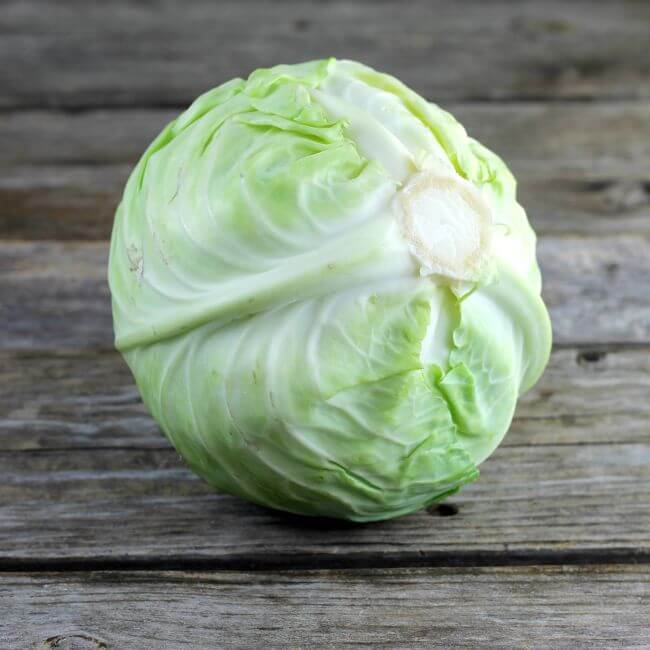 Head of cabbage on a table.