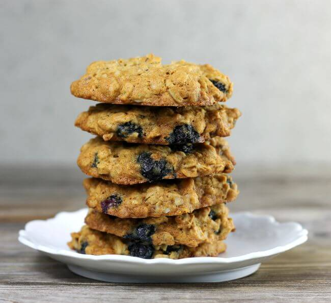 A stack of blueberry oat cookies on a white plate.