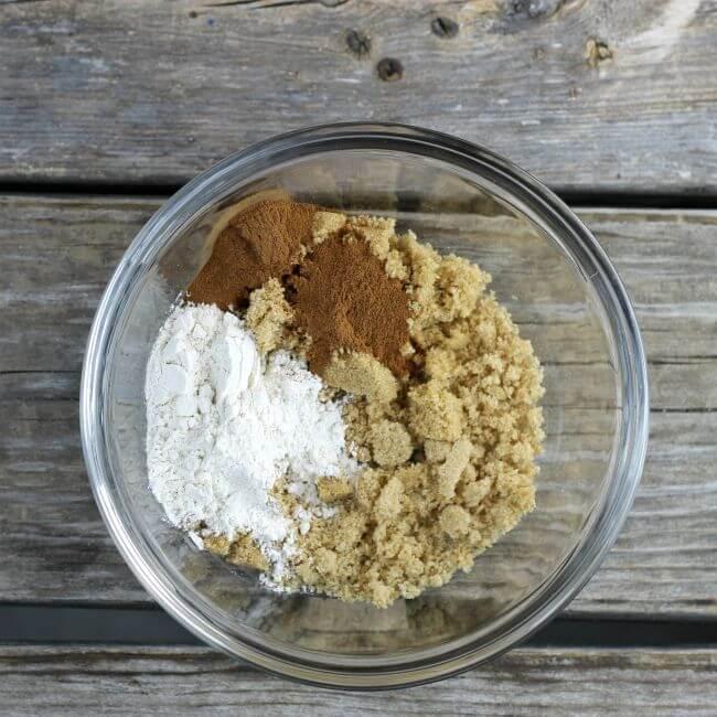 Brown sugar, cinnamon, and flour in a bowl.