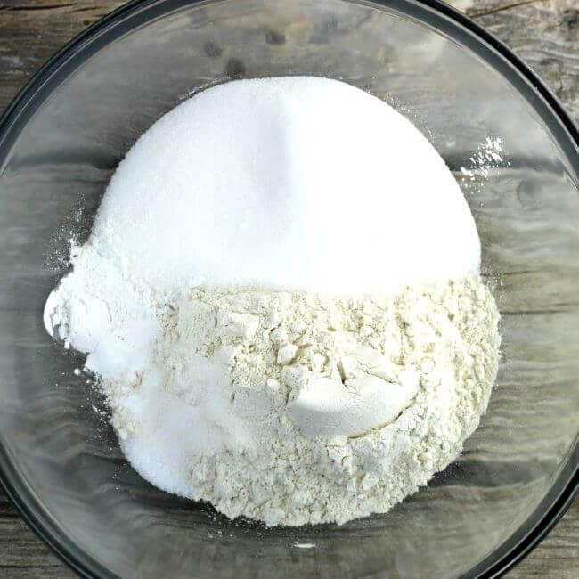 Flour and sugar in a glass bowl.