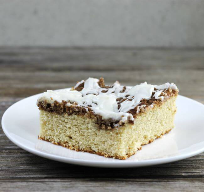 A piece of coffee cake on a white plate.