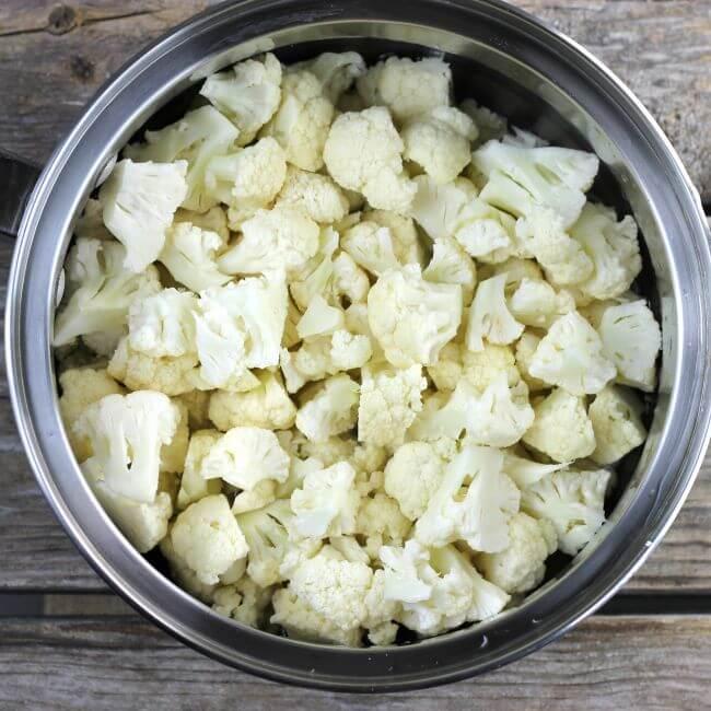 Cauliflower florets in a saucepan.