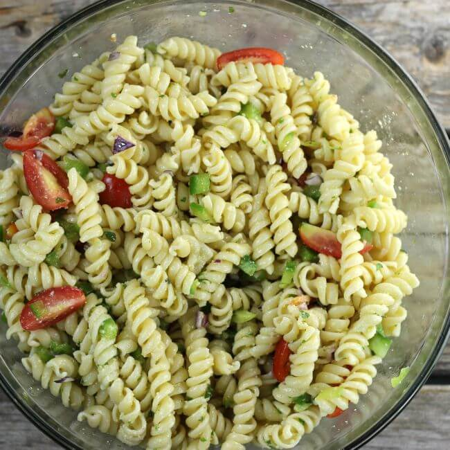 Pasta salad in a glass bowl.