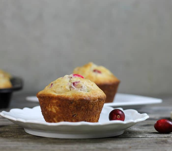 Cranberry Clementine oat muffins filled with fruit, nuts, and oats perfect for breakfast on the go.