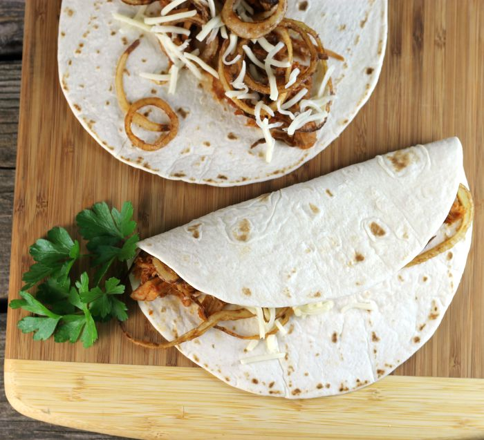 BBQ pork tacos are not your everyday tacos. A fun way to service BBQ pork.