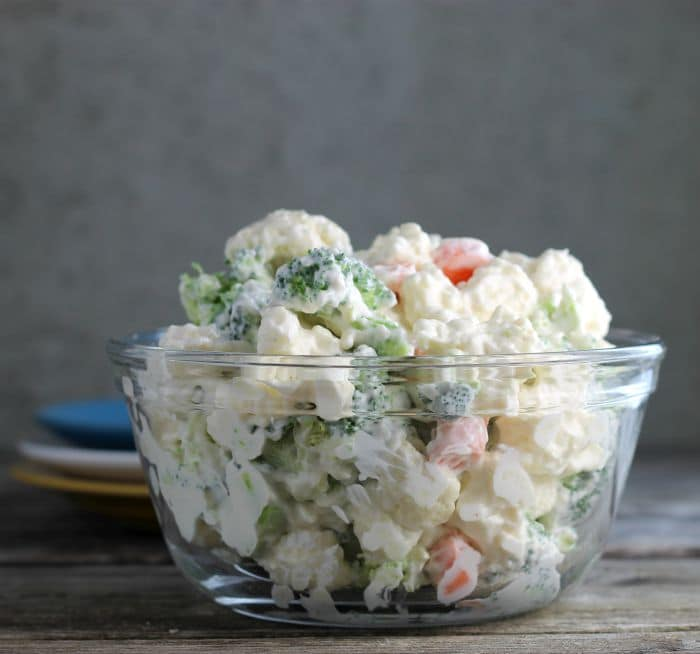 Cauliflower Broccoli Salad is a cold side salad that is covered in a creamy dressing and is a great side dish to make for a large group.