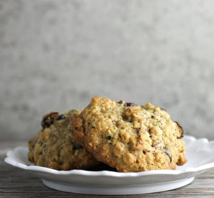 Zucchini cranberry oatmeal cookies are cakey cookies that are filled with zucchini, dried cranberries, pecans, and oatmeal.