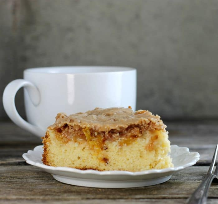 Fresh peach coffee cake is a soft moist cake topped with fresh peaches, crumble topping and icing. It is great to make on lazy Sunday mornings.