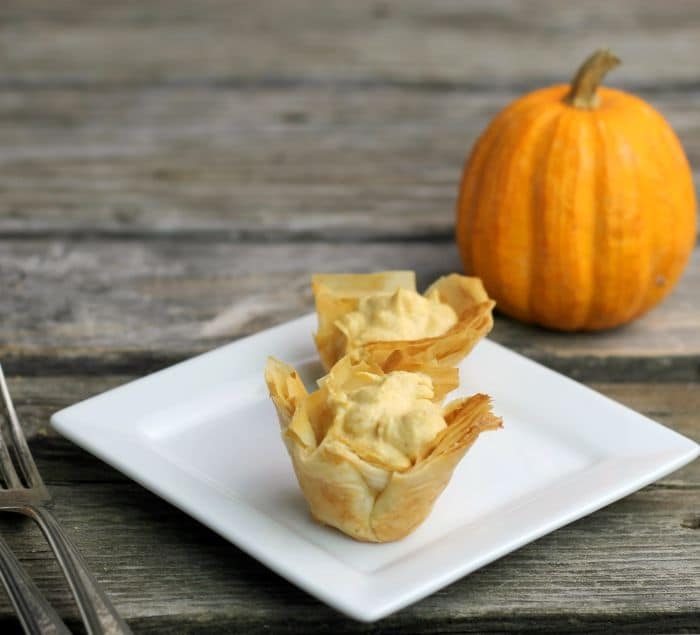 Mini Pumpkin Pie Tarts have a crispy phyllo shell and a no-bake pumpkin cream cheese filling perfect for the holiday season.