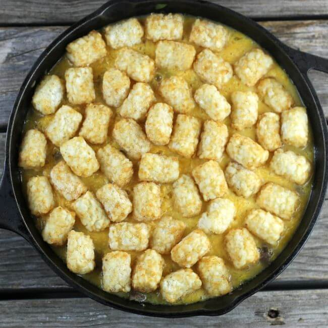 Cast-iron skillet with tater tots and eggs