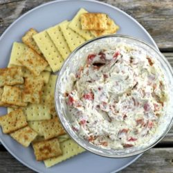 Pepperoni Dip on a gray plate with crackers.