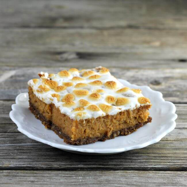Sweet Potato bars with marshmallow topping on a white plate.