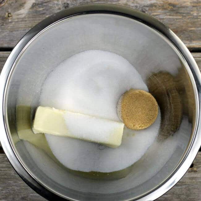 Butter and sugar in a stainless steel bowl