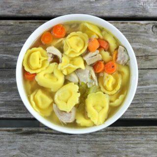 Chicken Tortellini in a white bowl.