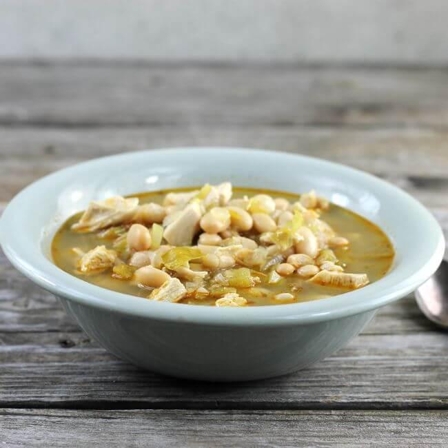 White chicken chili in a green bowl.