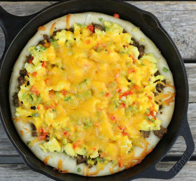 Baked sausage breakfast pizza in a cast-iron skillet.