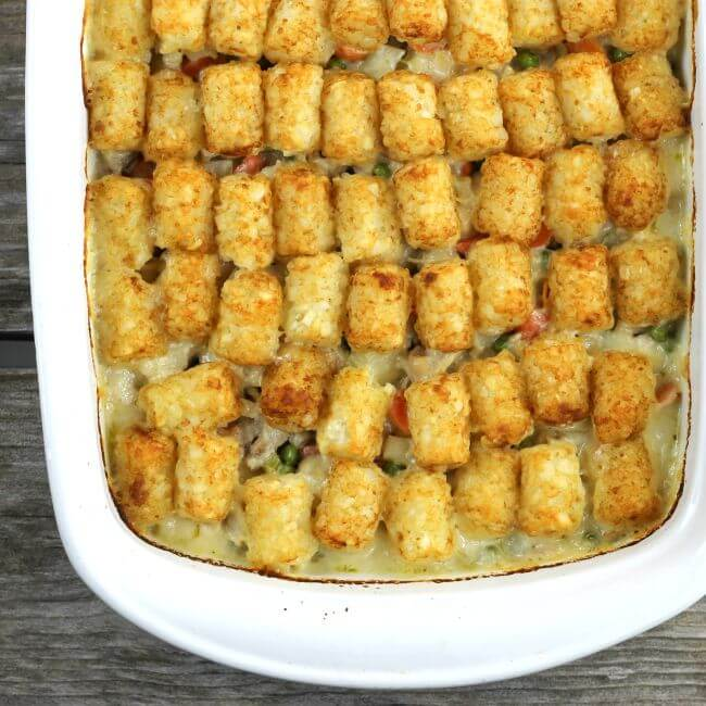 Baked tater tot chicken tater tot casserole in a baking dish.