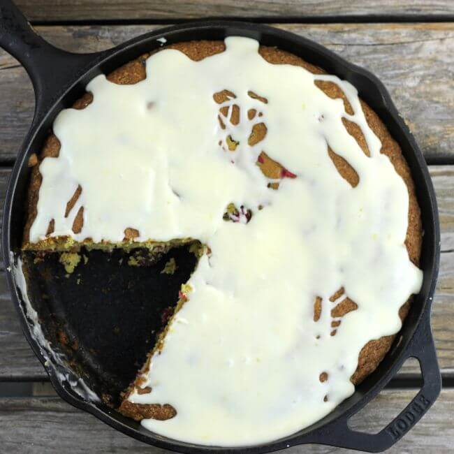 Cake in the skillet with one piece removed.