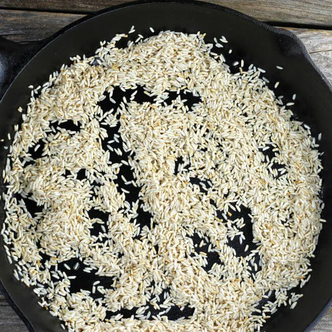 Rice that has been fried in a cast-iron skillet.