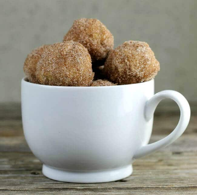 Muffins in a white coffee mug.