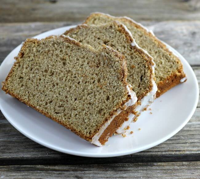 Angle view of cinnamon bread on a white plate.