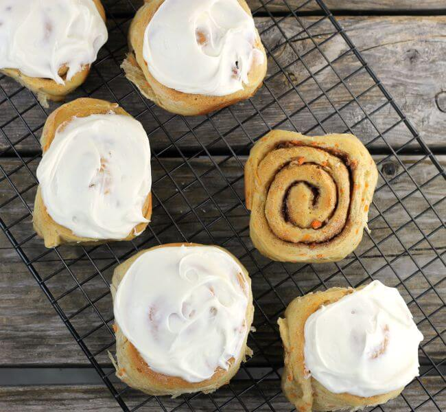 Sweet rolls on a cooling rack.